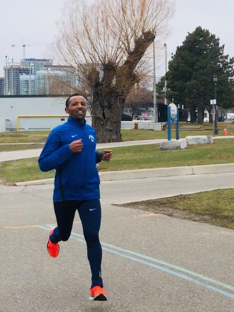 """Berhanu finishing 1st!  He makes running look effortless!  This was just a """"training"""" run.  Incredible to post a fast time after having taken a break during the winter months from intense training."""